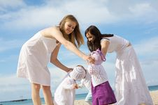Free Happy Mothers With Children At The Beach Royalty Free Stock Image - 14382976