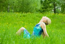 Free Girl Rests On The Grass Stock Photography - 14383442