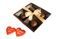 Free Candies In The Package With Ribbon And Two Hearts Royalty Free Stock Photography - 14383697