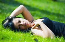 Free Portrait Of Beautiful Brunette Lying On Grass Royalty Free Stock Photo - 14384675