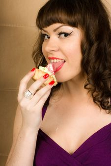 Sexy Girl In Purple Dress And Cake Royalty Free Stock Photography