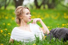 Girl Relaxing In Dandelions Royalty Free Stock Photo