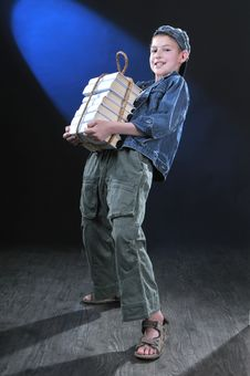 Boy And Heavy Books Royalty Free Stock Photography