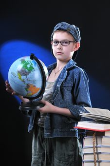 Boy And Globe Royalty Free Stock Photography
