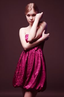 Seductive Young Woman Wearing On Pink Dress Royalty Free Stock Photography