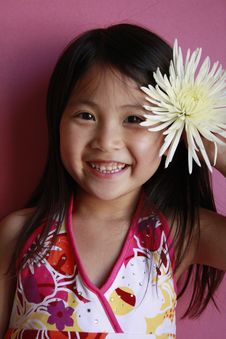Free Little Asian Girl With Flower Royalty Free Stock Photography - 14389497