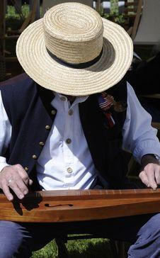 Civil War Actor Playing Dulcimer Stock Image