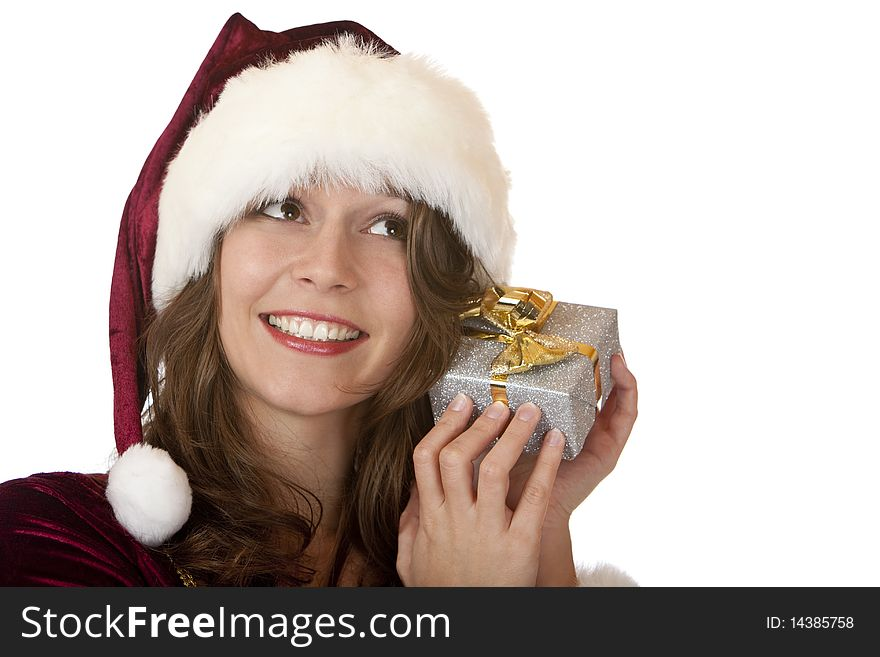 Happy Santa claus woman holds Christmas gift