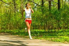Free Pretty Girl Jogging Royalty Free Stock Photo - 14391435