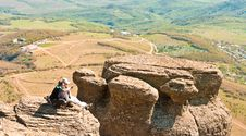 Free Two Travellers Sitting On The Rock Royalty Free Stock Image - 14395886