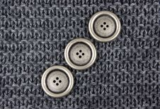 Knitted Fabric And Buttons Royalty Free Stock Images