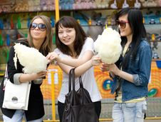 Free Three Girls Eating Candy Floss Stock Photo - 14397870
