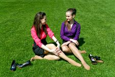 Young Businesswomen Relaxing On The Grass Royalty Free Stock Photography