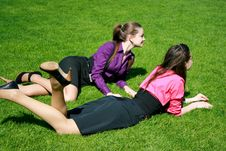 Free Young Businesswomen Relaxing On The Grass Royalty Free Stock Images - 14398149