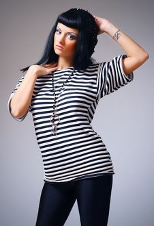Free Woman Posing In A Striped Top Royalty Free Stock Image - 14399526