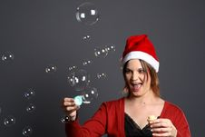Young Santa Girl Bubbles Stock Images