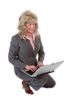Business Woman Kneeling Working On Laptop Stock Photos