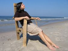 Free Girl And Wooden Chair On The Beach Royalty Free Stock Photos - 1445058