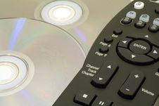 Free TV Remote Control With DVDs Royalty Free Stock Photo - 1447225