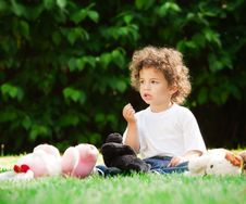 Free Small Boy Sitting On Grass Stock Photos - 14400233