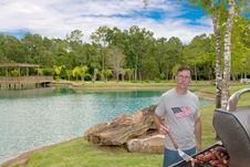 Free Mature Man Barbecuing Stock Photography - 14402162
