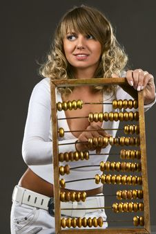 Free Girl Calculates With An Abacus Stock Photography - 14404142