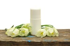Free Deodorant Cosmetic Bottle And Flower Stock Photos - 14404193