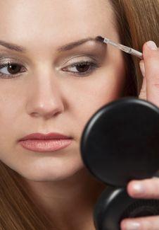 Free Woman Applying Make Up Stock Photos - 14404243