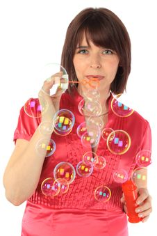 Free Cheerful Woman Starts Up Soap Bubbles Stock Image - 14404301