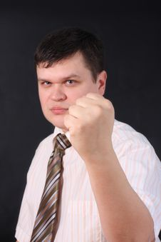 Serious The Man Shows A Fist Royalty Free Stock Photos