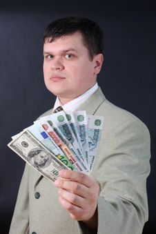 Free Man With Money For A Black Background Stock Photo - 14405090