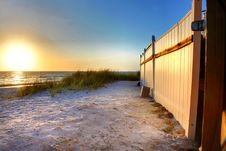 Free Sunset On White Sand Beach With Fence Royalty Free Stock Photography - 14409007