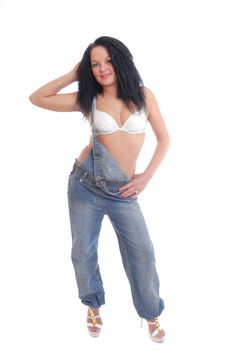 Free Pretty Girl In Bra And Dungarees Posing Royalty Free Stock Photography - 14409657