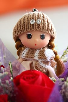 Rose And Doll Stock Photo