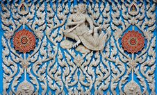 Traditional Thai Style Molding Art With Blue Glass Stock Images