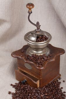 Antique Coffee Grinder With Fried Beans Royalty Free Stock Photo