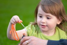 Free Little Girl With A Bubble Wand Royalty Free Stock Image - 14414036