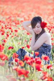 Free Young Girl In Poppies Field Royalty Free Stock Photography - 14414077