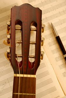 Free Guitar With Pen On Music Manuscript Royalty Free Stock Photos - 14415428