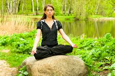 Free Pretty Girl Doing Yoga Near The Lake Royalty Free Stock Image - 14415456