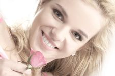Free Portrait Of A Young Blond Holding A Pink Rose Royalty Free Stock Images - 14416419