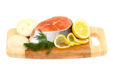 Free Salmon Steak, Lemon And Onions On A Cutting Board Stock Photo - 14417300