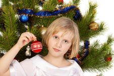 Free Nice Girl Decorates Christmas Tree Stock Images - 14418394