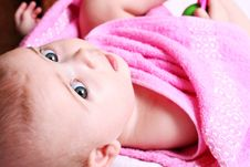 Baby In A Pink Towel Stock Photo