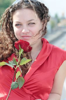 Girl With A Smile And A Rose In His Hand Stock Images