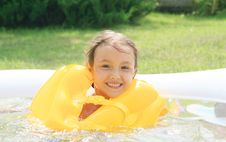 Girl In The Rescue Life Buoys Royalty Free Stock Images