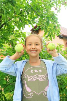 Free A Smiling Girl With Apples Royalty Free Stock Image - 14421716