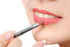 Applying Liquid Glossy Lipstick Stock Photography