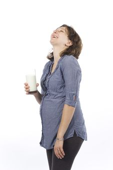 Free Pregnant Woman With Glass Of Milk Stock Photos - 14423993