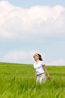 Free Happy Girl In Green Grass Royalty Free Stock Photography - 14424677